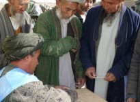 Men_of_northern_Afghanistan_preparing_to_vote_in_2004