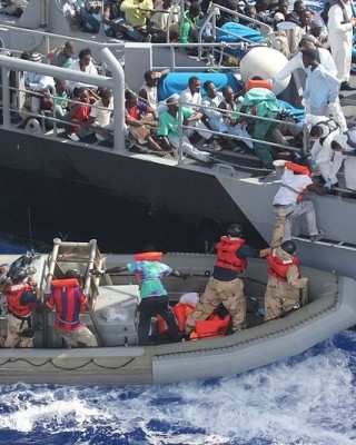 Distressed_persons_are_transferred_to_a_Maltese_patrol_vessel.