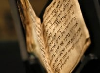 A 1,200-year-old Jewish prayer book, or siddur, is displayed at the Bible Lands Museum in Jerusalem on September 18, 2014. Originating from the Middle East, the 50-page-long book written in Hebrew is the oldest known manuscript of Jewish prayers. AFP PHOTO/GALI TIBBON / AFP PHOTO / GALI TIBBON