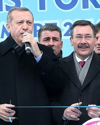 TO GO WITH AFP STORY BY BURAK AKINCI  In this photo taken on March 13, 2014 Ankara's mayor Melih Gokcek (R), who will run for a fifth term in the March 30 election, stands next to Turkish Prime Minister Recep Tayyiup Erdogan during the inauguration of a subway in Ankara. AFP PHOTO / ADEM ALTAN / AFP PHOTO / ADEM ALTAN